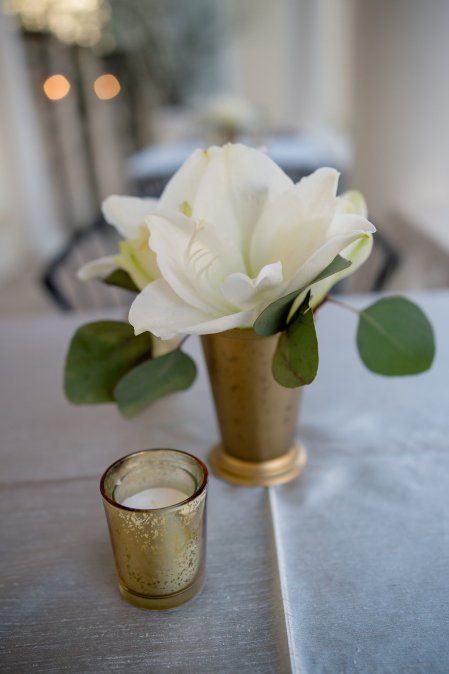 White amaryllis in gold mint julep cup.