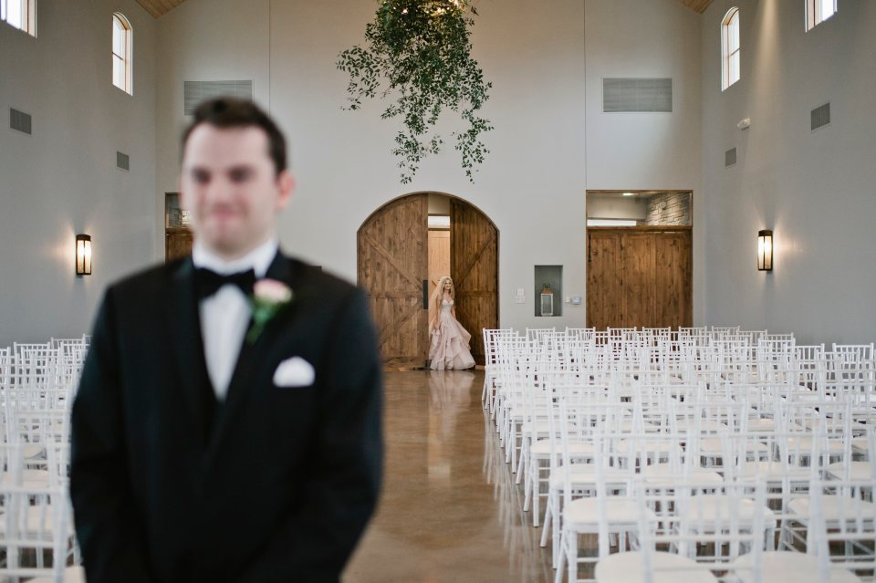 Groom anticipating the arrival of bride for the first look.