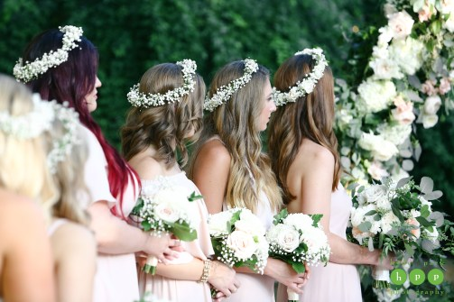 Bridesmaids with baby's breath flower crowns.