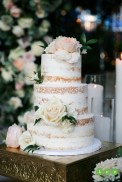 Nearly naked cake accented with fresh flowers.