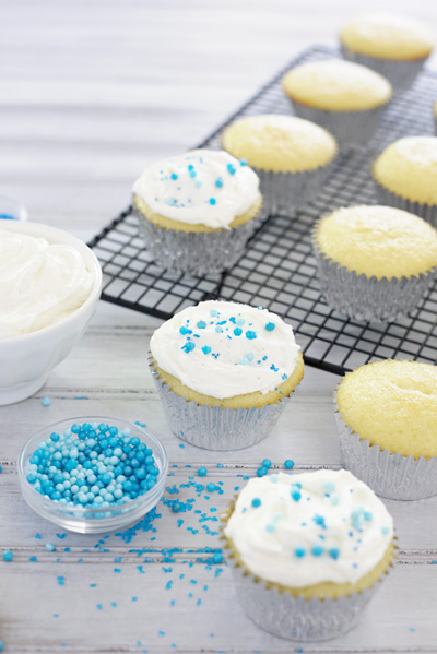 Vanilla Bean Cupcakes with Fluffy White Frosting | BourbonandHoney.com