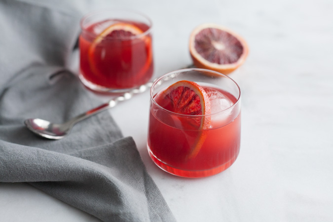 Blood Orange Negroni | BourbonandHoney.com -- This delicious Blood Orange Negroni is citrusy, light and the perfect cocktail to brighten your winter.