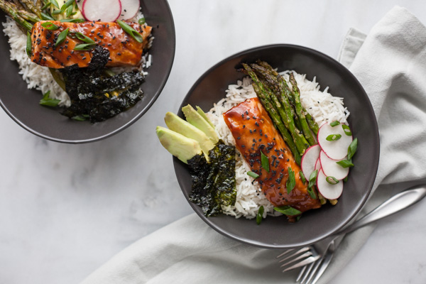 Soy Glazed Salmon Rice Bowl | BourbonandHoney.com -- Sweet and spicy soy glazed salmon topped with avocado, roasted asparagus, these salmon rice bowls are an easy favorite!