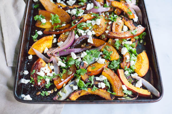 Spicy Roasted Pumpkin with Honey and Feta | BourbonandHoney.com -- This Spicy Roasted Pumpkin recipe is a quick and easy gluten free side dish with sweet caramelized honey, feta cheese and pumpkin seeds.