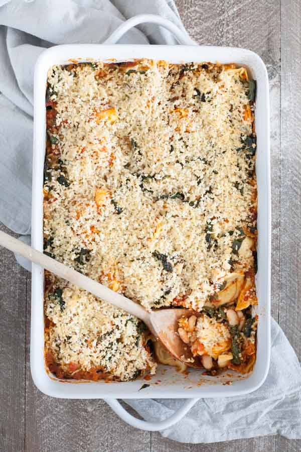 Baked Tortellini from One Pan & Done by Molly Gilbert | BourbonandHoney.com -- Cheesy pasta, kale, tomatoey beans and a crunchy panko topping make this Baked Tortellini a hearty and comforting weeknight dinner that's ready for the oven in just 15 minutes!