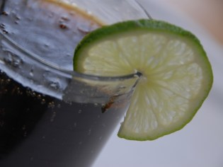 Rum and coke with twist of lime