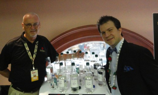 "Four Roses Master Distiller Jim Rutledge and BourbonBlog.com's Tom Fischer next to the 10 Unique Recipes of Four Roses in their ""White Dog"" un-aged form to sample"