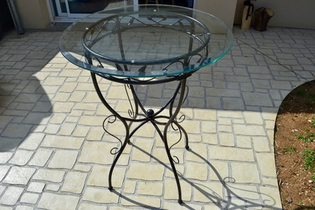 table en verre et fer forge ronde bourges