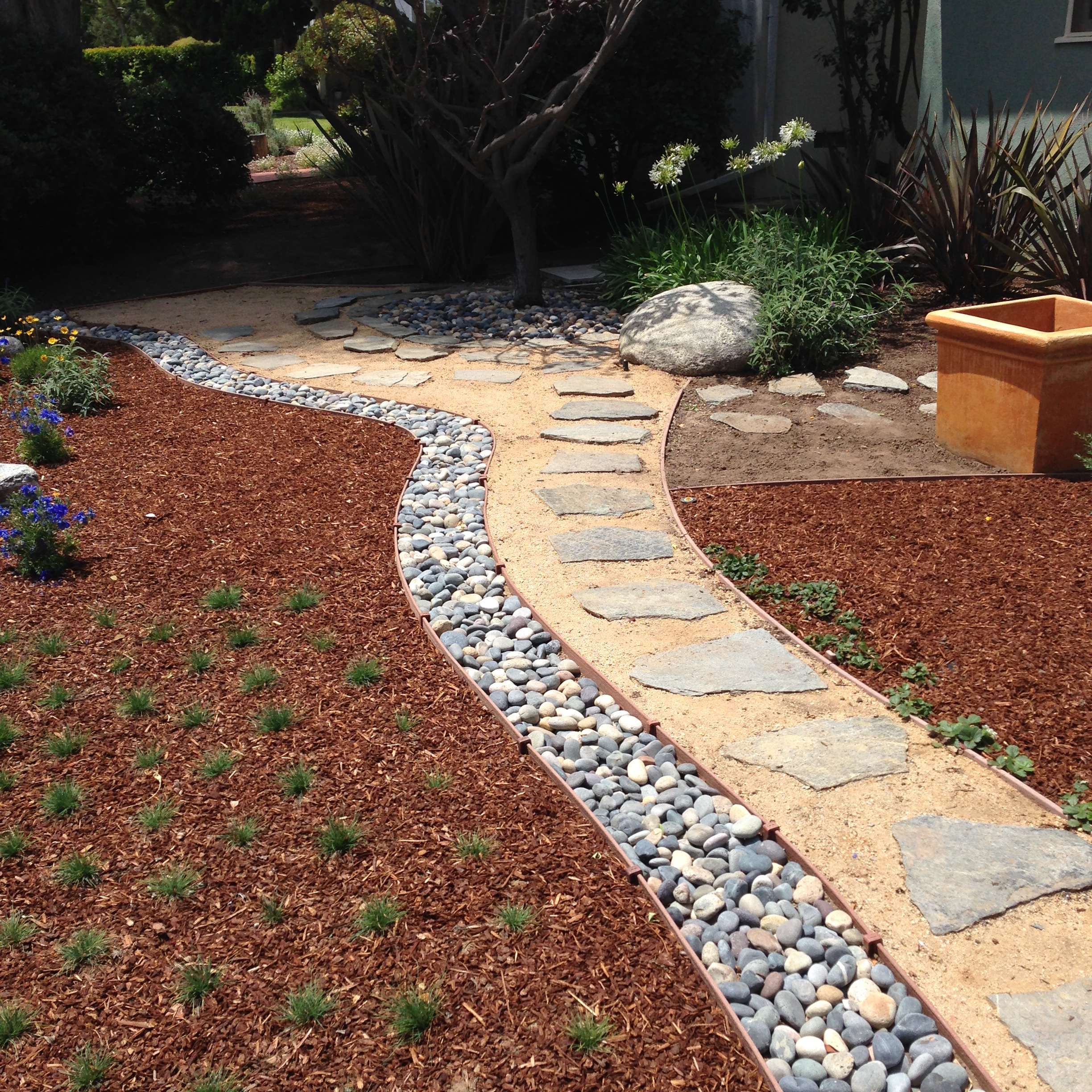 Start Xeriscaping With a Backyard Rock Garden - Bourget Bros on Xeriscape Backyard Designs  id=62933