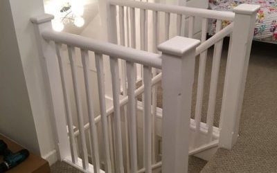 Glossing a set of stair railings.