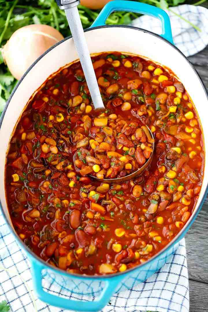 A dutch oven full of smoky vegetarian chili.
