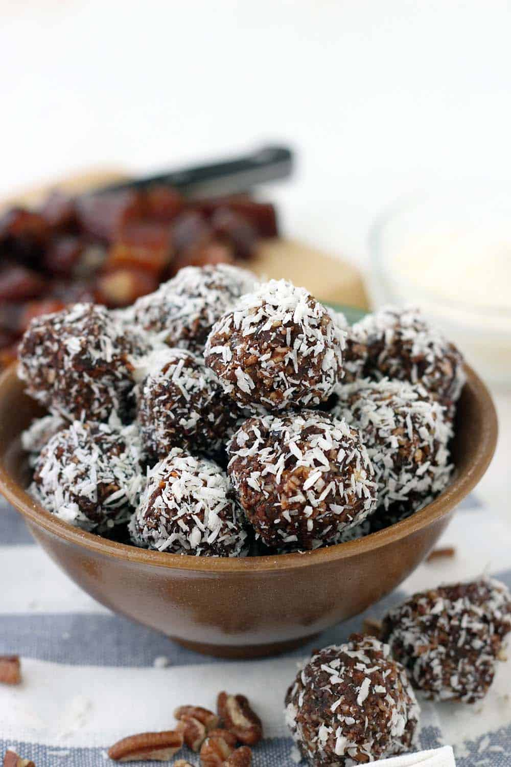 These Whole30 / Paleo chocolate coconut energy balls are an amazing midday snack and energy boost! Sweetened only with dates and super easy to make, they taste decadent, similar to an almond joy, but are 100% guilt-free.
