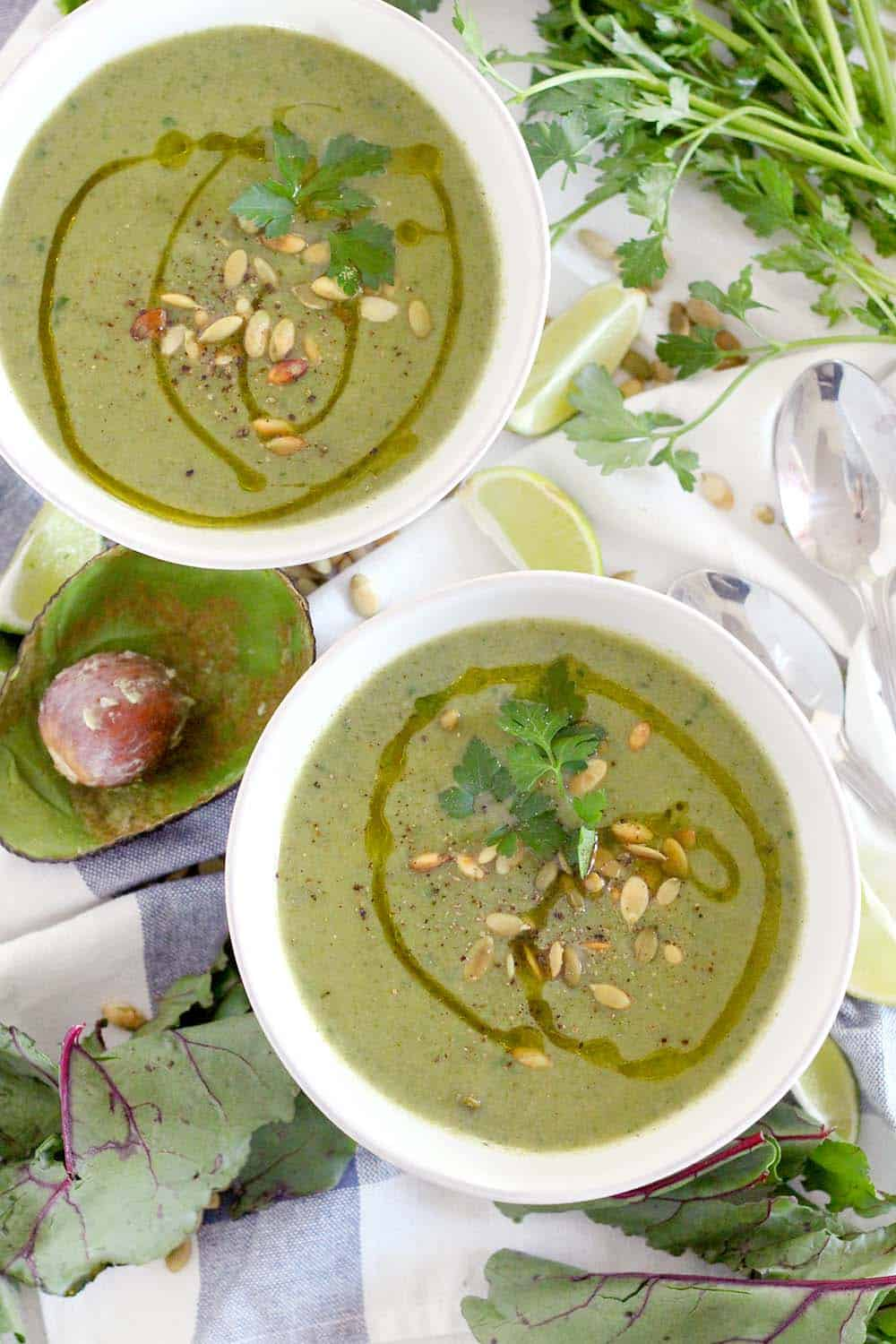 This Broccoli Avocado Soup with Beet Greens is creamy, vegan, and SUPER healthy. I love this soup as a detox after over indulging! You can use spinach, kale, or other greens as well. | www.bowlofdelicious.com