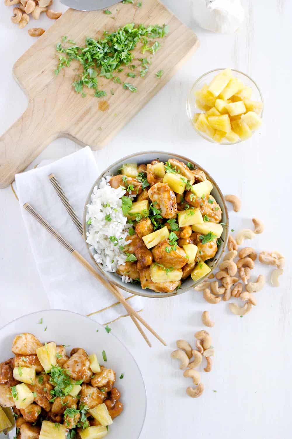 This skinny pineapple chicken with cashews is a healthy, low-fat stir fry you can make in 20 minutes! Naturally sweetened from fresh pineapple in a thick and delicious sauce brown sauce.