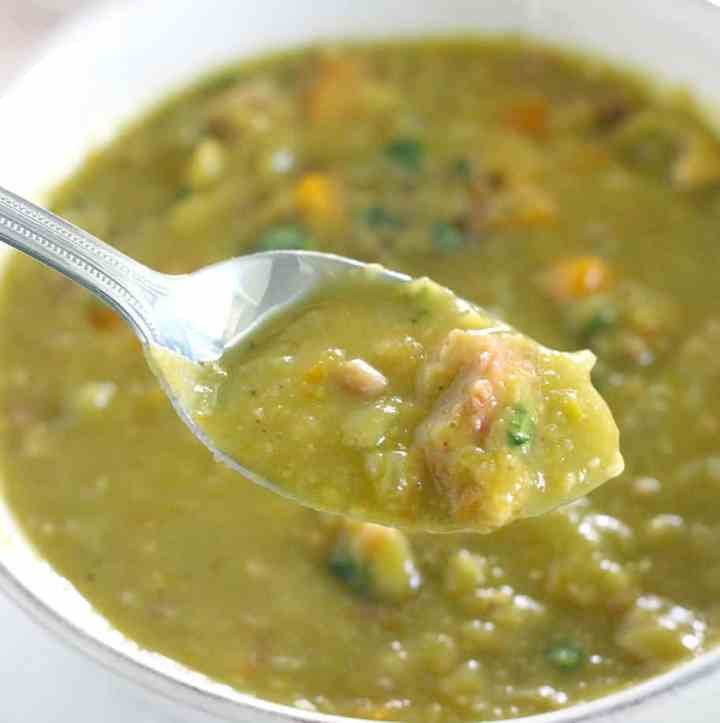 A spoonful of split pea soup with ham