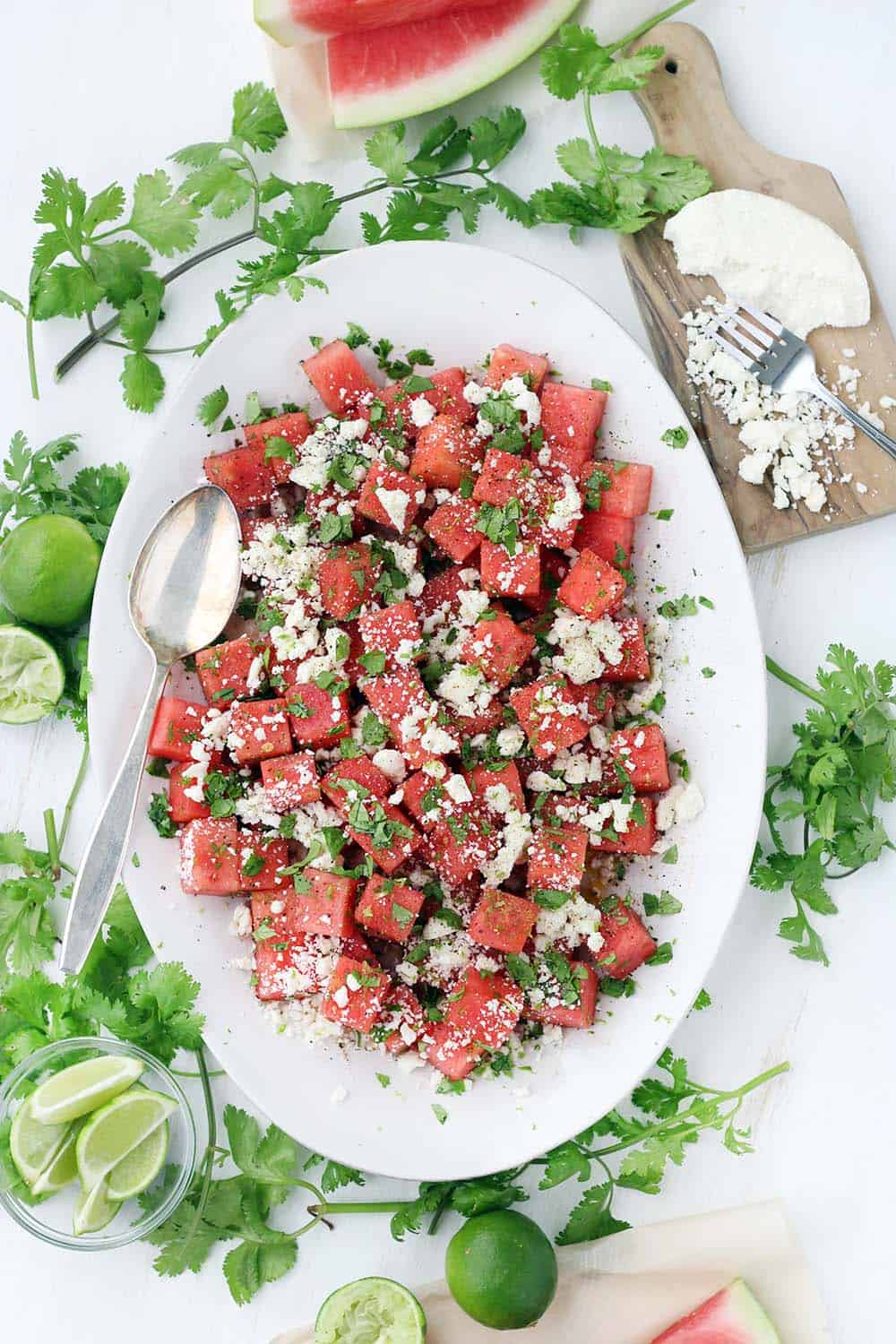 This refreshing watermelon salad with queso fresco, lime, and cilantro is the perfect balance of sweet and salty! It's easy to make this vegetarian side dish in advance and perfect for your summer festivities.
