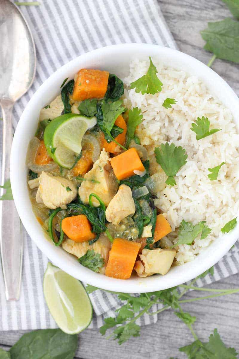 Green Chicken Curry with Sweet Potatoes and Spinach is such an easy, flavor-packed, veggie-packed recipe! This version is dairy free, gluten free, and paleo/whole30 compliant.