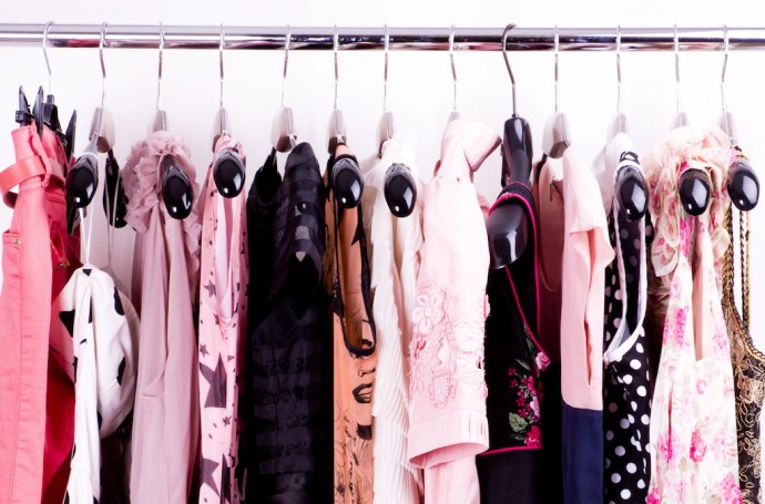Fashionable clothes on pegs in a cloak-room; Shutterstock ID 100688977; PO: aol; Job: production; Client: drone