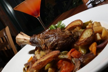 Lamb Shank with truffled root vegetables and roasted potatoes.