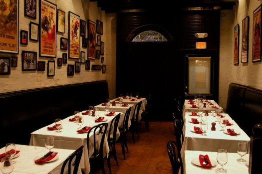 The Oyster Room is hung with authentic bull-fighting posters, and accented with Pamplona's signature red.