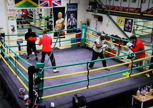 Boxing FAQ - Boxers training in boxing gym