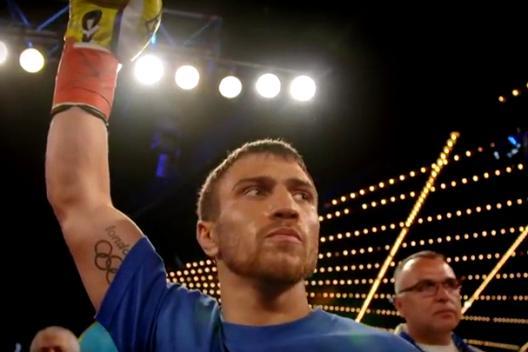 Vasyl Lomachenko celebrates victory