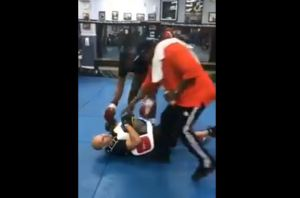 Boxer Knocking Out Trainer
