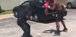 cop boxing a guy on the street