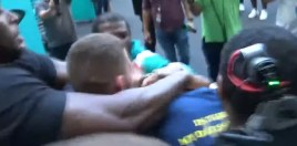 Floyd Mayweather and Jake Paul Brawl and Teams Trade Blows