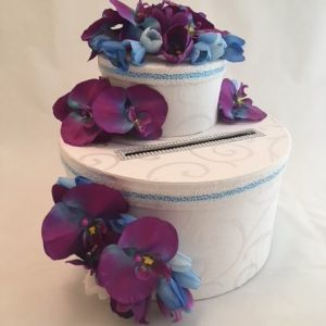 Wedding card box, purple orchids, blue tulips, blue ribbon, white material with subtle pattern and bling