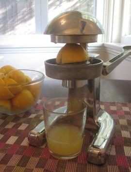 Juicing lemons for strawberry mint lemonade