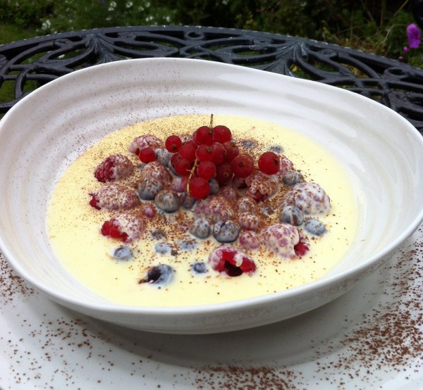 Frozen summer berries with hot white chocolate sauce