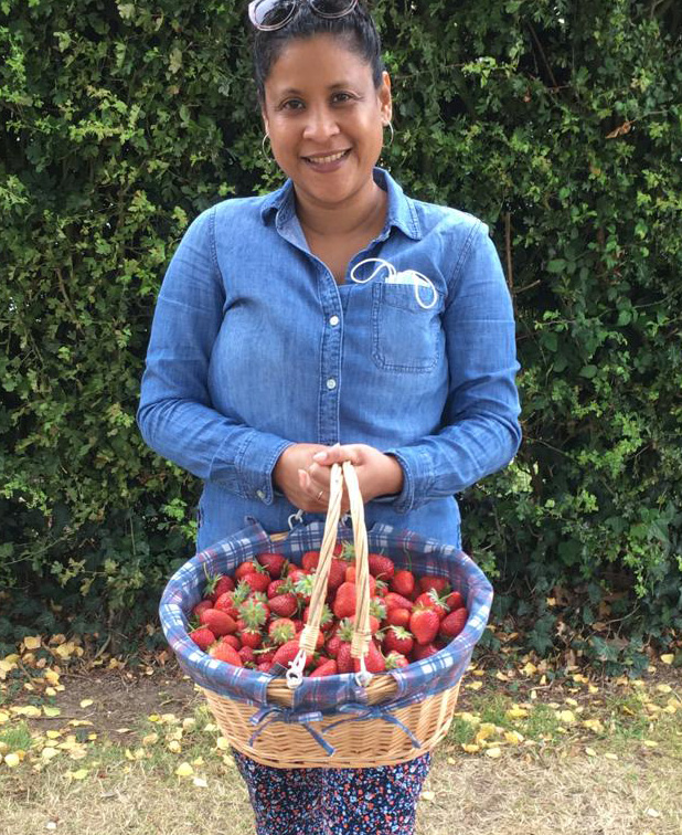 A farm regular celebrating her birthday by picking strawberries.