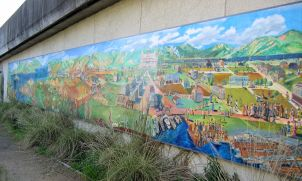 Photo of History of Berkeley as seen in a park mural along the BART tracks near Gilman St.