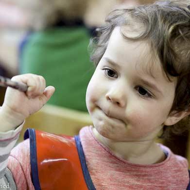 Child Painting at Batman Park Kindergarten