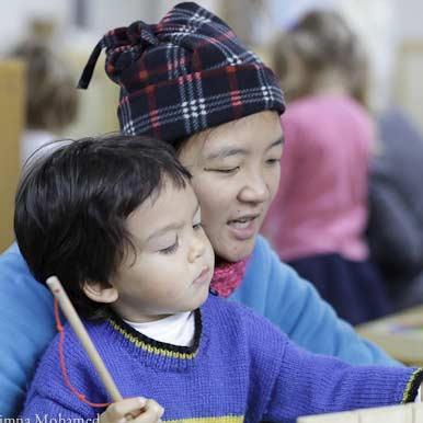 Child with teacher at Batman Park Kindergarten