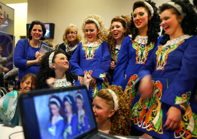 Boston-3/29/13- Dancers from the Coyle School of Irish Dance in Philadelphia laugh as they look at gout photos of themselves on a computer taken by a studio photographer set up at The World Irish Dancing Championships being held at the Hynes Convention Center.  It is only the second time in it's 40 year history that the eight-day event is held outside Ireland and Scotland. Organizers expect twenty-thousand people from around the globe to attend the event.