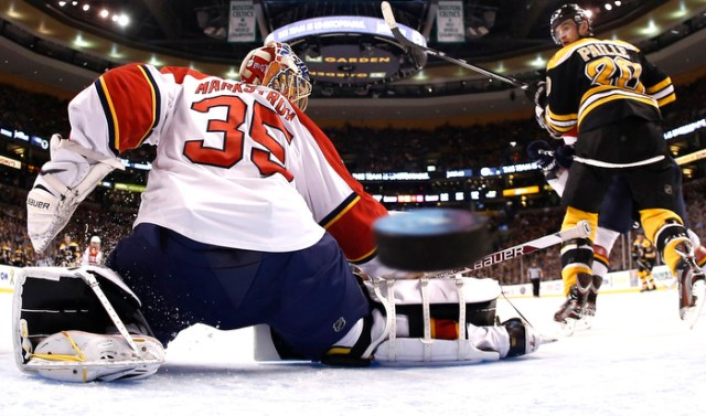 Apr 21, 2013; Boston, MA, USA; Florida Panthers goalie Jacob Markstrom (35) can't stop this goal by Boston Bruins' Dougie Hamilton (not seen) as Boston Bruins left wing Daniel Paille (20) looks on during the second period of a NHL game.
