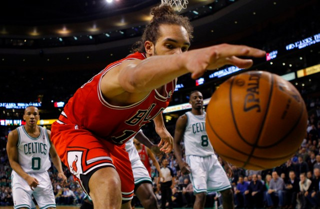 Chicago Bulls center Joakim Noah cannot keep keep the ball inbounds in the second half of their NBA basketball game against the Boston Celtics in Boston, Massachusetts February 13, 2013.