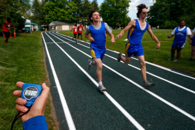 Eddie Cox (L) and his teammate, fellow student and guide runner Daniel Cannon, both from the West Virginia School for the Blind, compete  at the 67th annual Eastern Athletic Association for the Blind track and field tournament hosted at the Perkins School for the Blind in Watertown, Massachusetts May 18, 2013.