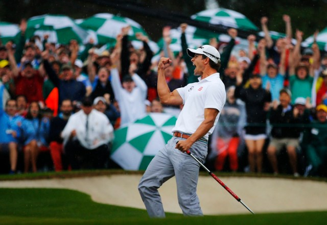 Adam Scott of Australia celebrates sinking a birdie putt on the 18th green during final round play in the 2013 Masters golf tournament at the Augusta National Golf Club in Augusta, Georgia, April 14, 2013.