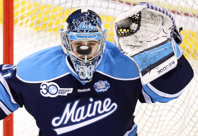Maine goaltender Martin Ouellette eyes a Boston College shot during the first period of a college hockey game at Conte Forum.