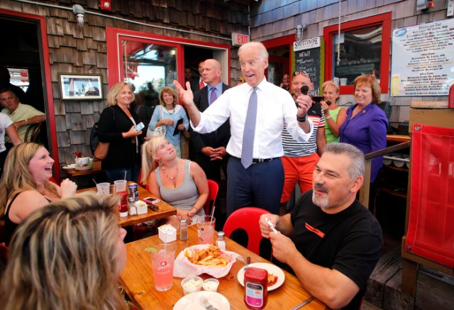 United States Vice President Joe Biden greets patrons at the Old Ferry Landing restaurant while making a stop for lunch in Portsmouth, N.H. Wednesday, Sept. 3, 2014.