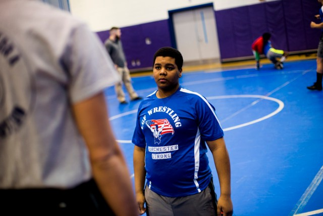 Carlos, 14. He came to the U.S from Portugal and was introduced to wrestling by his teachers and classmates one year ago.