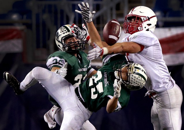 Dartmouth's Luke Espindola (25) breaks up a long pass intended for Melrose wide receiver Mike Pedrini in the Division 3 high school Super Bowl at Gillette Stadium.