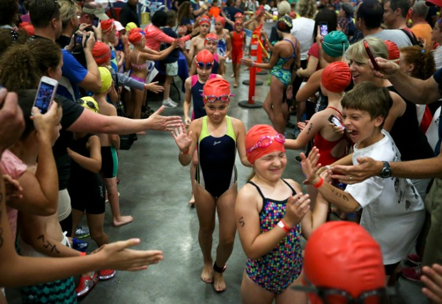 More than 1,000 youngsters gathered at the Massachusetts Institute of Technology to swim, cycle, and run during the fourth annual New England kids triathlon on July 19, 2015. The first 50 competitors received tons of support as they headed to the pool to start off the games.