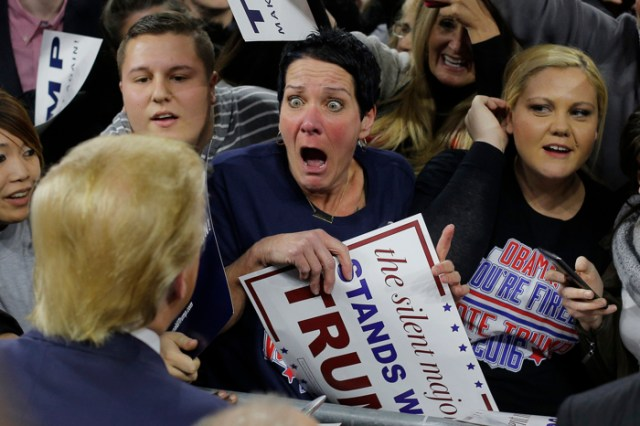 Audience member Robin Roy (C) reacts as Republican presidential candidate Donald Trump greets her at a campaign rally in Lowell, Massachusetts January 4, 2016.