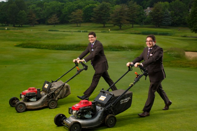 6/5/16 - Newton, MA - Identical twins Ed (purple tie) and Rich (pink tie) Reynolds, have shared every job they've ever had. They're now bankers, but from the age of 14, when they mowed lawns at the same golf course near their native Worcester, 31-year- olds Ed and Rich have lead identical careers.