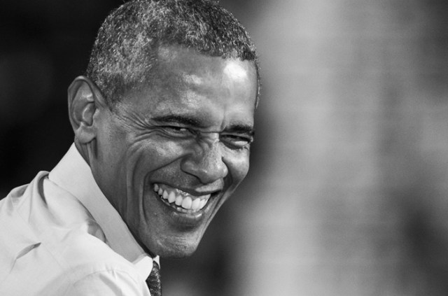 Nov. 7, 2016 – President Barack Obama laughs as he recounts moments from his election process at a rally in support of Democratic presidential candidate Hillary Clinton at the University of New Hampshire.