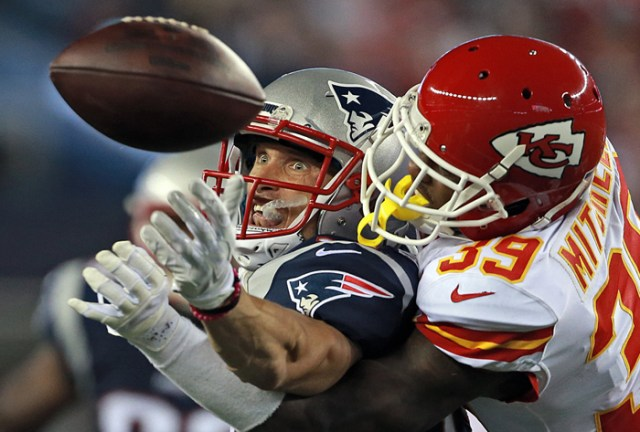 New England Patriots wide receiver Chris Hogan keeps his eyes on the ball as Kansas City Chiefs cornerback Jacoby Glenn keeps him from receiving the catch during the second quarter of the NFL game at Gillette Stadium